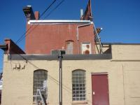 Repainting Exterior Old Commercial Brick Building